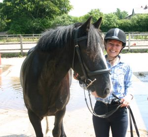 Me looking very happy with Coco the pony after one of my riding lessons