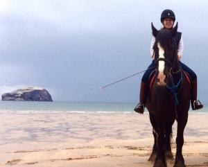Jane Allan riding a horse