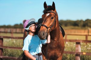 Bay sport horse with owner Jade