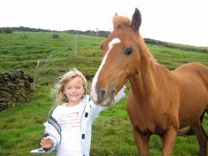 Charlotte Lutener with her first pony when she was a child