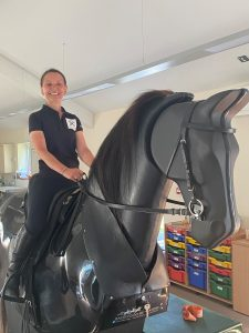 image of Sharon Howe riding a mechanical horse