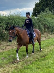 Sharon riding Riley her beloved pony